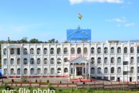 """Shillong, June 23: The Meghalaya High Court on Wednesday observed that """"requirement of vaccination should be directory and not mandatory"""", even as it clearly and unequivocally stated that """"vaccination is the need of the hour"""" and in fact """"an absolute necessity in order to overcome this global pandemic"""". Taking up for hearing a PIL moved by the Registrar General of the Court against the Meghalaya Government for making it mandatory for shopkeepers, vendors, local taxi drivers and others to get themselves vaccinated before they can resume their businesses, a division bench of Chief Justice Biswanath Somadder and Justice H.S.Thangkhiew observed that the advice of the Principal Secretary to the Government of Meghalaya, Health and Family Welfare Department that the orders for vaccination should be seen as """"persuasive advisory"""" and """"not as a coercion"""", was a """"step in the right direction"""". """"Article 21 encompasses within its fold, right to health, as a fundamental right. By that same analogy, right to health care, which includes vaccination, is a fundamental right,"""" the bench noted. """"However, vaccination by force or being made mandatory by adopting coercive methods, vitiates the very fundamental purpose of the welfare attached to it. It impinges on the fundamental right(s) as such, especially when it affects the right to means of livelihood which makes it possible for a person to live,"""" the order stated. The Court also stated that the order issued by the Deputy Commissioner, East Khasi Hills district for all shops and commercial vehicle drivers to display signs of their vaccination status should be complied with, so that the public at large are provided with an option of making an informed choice. The Court also directed all shops/establishments/local taxis/auto-rickshaws/maxi cabs and buses to prominently display at a conspicuous place, a sign, """"VACCINATED"""", in event of all employees, staff, driver or conductor or helpers are vaccinated and a sign, """"NOT VACCINATED"""", if they"""